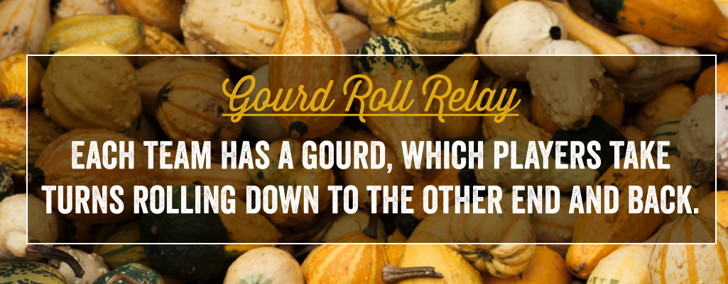 Each team has a gourd, which players take turns rolling down to the other end and back